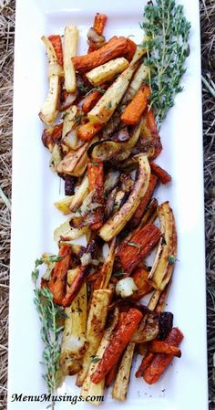 Roasted Carrots and Parsnips - one of my favorite cool weather side dishes. Roasting the veggies brings out so much sweetness. Both rustic and elegant all at the same time!