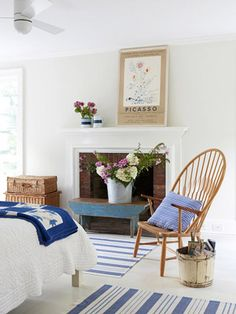 Minimal country style...like a relaxing cottage escape!  The fireplace makes the white room warm.