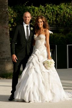 Australian model, Rebecca Twigley, wore a strapless J'Aton gown for her wedding to Chris Judd