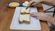 Hand spreading butter onto two slices of thick white bread. Perfect Grilled Cheese, Different Types Of Bread, Homemade White Bread, Grill Cheese Sandwich Recipes, Sweet Cornbread, Recipe Please, Slice Of Bread, Melted Cheese, Cheddar Cheese