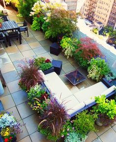 Now if a backyard just isn't available to you, then think outside the box...this bad *ss rooftop garden and patio is a gorgeous option! Lane