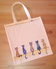 Items similar to Patterned Cats Hand-painted Canvas Bag on Etsy : Hand-painted Canvas Bag by PaintbrushAndPen on Etsy Painted Canvas Bags, Canvas Tote Bags, Diy Tote Bag, Painted Clothes, Jute Bags, Fabric Bags, Reusable Bags, Cotton Bag, Fabric Painting