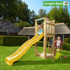 Jungle Tower - An open plan climbing frame for a small garden with simplicity as its strength, based around a sandbox, ladder and curved slide.