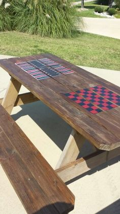 Picnic table with painted checkerboard and backgammon table. http://www.facebook.com/dustybootdesigns