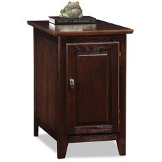 Enhance your living room's functionality and beauty with this wooden storage end table. This pretty table is ideal for holding books, DVDs, and other items out of sight. It has an amply sized top for displaying a lamp or other items.