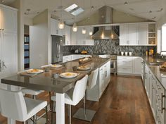 Kitchen with dining area and kitchen island train ego