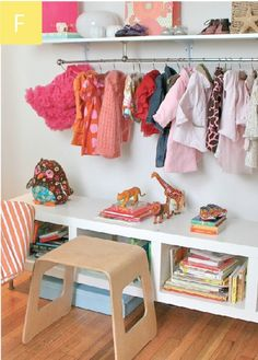 """""""Short on storage but not on style, I created a baby boutique at one end of the bedroom. I simply hung a polished nickel curtain rod from the bottom of industrial shelving."""""""