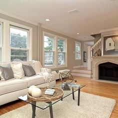 Gray Walls With Light Natural Hardwood Flooring For The
