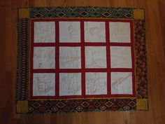 2014 travel quilt, red thread embroidery, machine quilted with fabrics from out west.  Jill McCowan original.