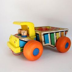 Fisher Price Husky Dump Truck #145 from 1961. Description from etsy.com.