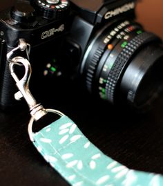 DIY camera wristlet. I would love this for the fact that I hate wearing my DSLR around my neck and usually wrap the strap around my wrist. Now if only I had a sewing machine and sewing skills....
