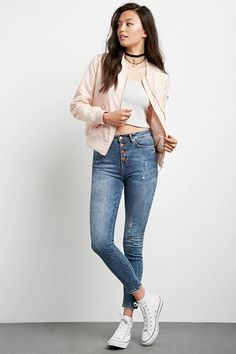 A pair of denim woven skinny jeans with a high-waisted fit, exposed button fly, and a five-pocket construction.#f21denim