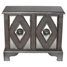 """Two-door wood accent cabinet with diamond motif facings and mirrored accents.   Product: Accent cabinetConstruction Material: Wood and mirrored glassColor: GreyFeatures:  Two doorsDiamond motif facings Dimensions: 30"""" H x 33.5"""" W x 18.5"""" DCleaning and Care: Wipe with a dry cloth"""