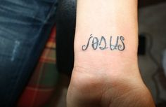 this is actually my friend's tattoo. look closely! it says jesus saves. :) do you see it?