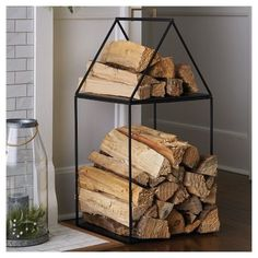 Keep your fireplace neat, organized and feeling incredibly cozy with this House Log Holder from Hearth & Hand™ with Magnolia. This house-shaped log holder features a simple linear design with a sturdy iron construction in a black finish. The roof has a gold handle so you can lift it off to move your wood logs around easily. You can store your firewood in a functional and beautifully designed iron log holder in the shape of a house.<br><br>Celebrate the everyday with H...
