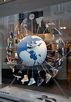 Around the world with Reebok shoe display. #retail #merchandising #window_display #shoes