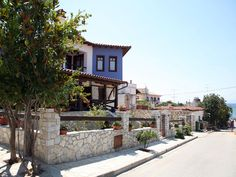 The long, winding road comes to an abrupt end 145 km from Thessaloniki and the airport, at the foot of an old tower. Halkidiki Greece, The Holy Mountain, Winding Road, Thessaloniki, Greece Travel, Traditional House, Tower, Houses, Mansions