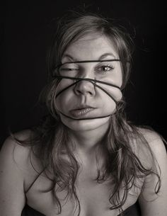 Models Disfigured by Wrapping Elastic Bands on Their Heads - My Modern Metropolis