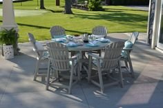 "A 60"" round outdoor table in beautiful light gray with comfy cushions. This set from Berlin Gardens makes an inviting spot on any deck or patio to enjoy time with friends and let the evening just slip away. #BerlinGardens #outdoordining #outdoorentertaining #patio"