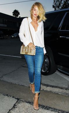 Rosie Huntington-Whiteley wears a button-down shirt, cuffed jeans, nude heels, and a Chanel bag