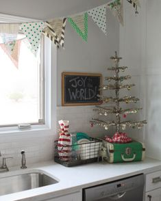 love everything the bunting the chalkboard the tree!!