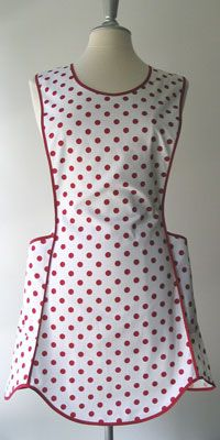 "EUNICE    RETRO APRON  RUBY DOT FABRIC  Eunice has a clever innovation we spied on a beautiful vintage flea market find. A single piece runs down the back to the waist. Simply thread the apron strings through one of three channels sewn into the back piece and tie a bow. The result? A flattering apron with three height adjustments, that fits an endless amount of ""widths"".    Two roomy pockets. 100% cotton."