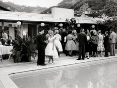 """Before he built his fabulous Hal Levitt-designed villa on Trousdale Place in 1964, producer/director Ross Hunter """"made do"""" with a smaller house (which I'm pegging as being located on lower Sunset Plaza/Rising Glen area). Here, he entertains at a 1959 party for Sandra Dee...whose future husband, Bobby Darin, may have lived right across the street -- in his fabulous butterfly-roofed bachelor pad now owned by hotelier Jason Pomeranc."""