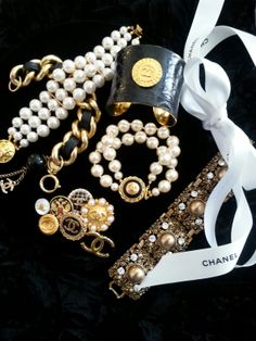 Vintage jewelry embellished with repurposed Chanel Buttons by DesignsbyZ contact zumphlette@aol.com