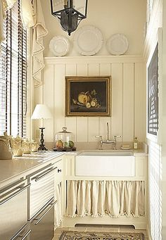 I don't normaly like rooms all white or cream, but I like this one. cottage kitchen