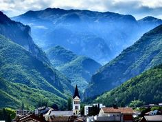 City of Peja and Rugova mountains from behind