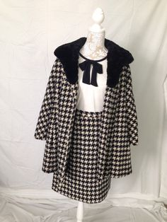 A late 1950's early 1960's houndstooth pencil skirt and open coat set. Now in the shop at One Sweet Thread. #onesweetthread #1950s #vintage #vintageskirt