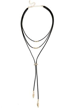 """Cool girls unite! The on-trend Lasso Good Gold and Black Choker Necklace is exactly what you've been waiting for, with a layered bolo style made from vegan leather strands, decorated in gold beads and feather charms. Shortest strand measures 14"""" around with a 3.5"""" extender chain."""