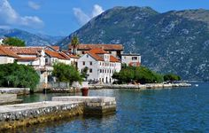 Photo about Photo of the houses by the sea at Kotor bay - Kotor Bay - Montenegro - July 2010. Image of behind, adriatic, mountains - 113951988