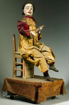 Gustave Vichy musical automaton of a clown playing a banjo, French, ca 1870.
