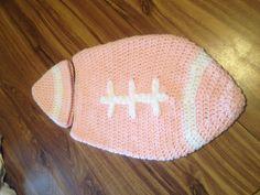 Baby girl crocheted football sleep sack.