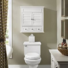 The large and spacious Lydia Medicine Cabinet from Crosley is a must for your bathroom storage needs. The stylish wall cabinet includes louvered doors that reveal a deep main cabinet. Below is a handy bottom drawer great for storing even more. Bathroom Wall Cabinets, Bathroom Furniture, Restroom Cabinets, Bath Cabinets, Toilet Storage, Bathroom Storage, Bathroom Ideas, Small Bathroom Makeovers, Bathroom Vanities