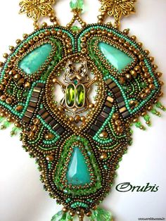 Awesome scarab jewel surrounded by Amazing embroidered jewellery by Orubis   Beads Magic