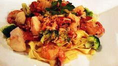 from 7/10/2015 - Seafood Sunrise - Jump shrimp, sea scallops, and lump crab meat with broccoli and sun dried tomatoes in a white wine sauce served over fettuccine.