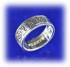 """Pagan Handfasting Ring - Your love is something special. Your rings should be, too. Theban runes spell out the words """"Hearts As One"""", celebrating the union of two souls. The inside has the same inscription in english. Bands are approximately 5/16"""" wide."""