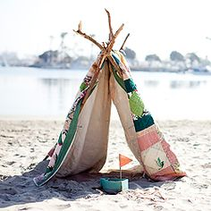 How to make a tent or fort out of sticks, twine and a quilt.
