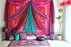 Indian sarees have been used to style this space.