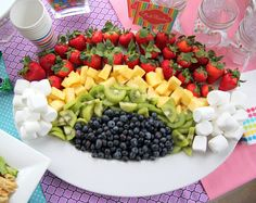 Rainbow fruit platter. Strawberries, pineapple, kiwi, & blueberries. Marshmallow clouds.