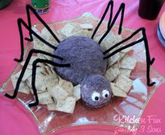 Spider Cheese Ball!!!  Cheese ball, Crushed blue tortilla chips, Cream cheese eyes, olive pupils!!  ~kitchenfunwithmy3sons.com
