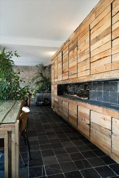 pallet kitchen WOW. MIGHT BE A LITTLE TOO PALLETY! (might have interspersed the floor tile, or a vivid tile color, in with the walls.) RP BY LINDA HAMMERSCHMID