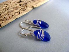 Something about this design just speaks to me. Cobalt Blue Wire Wrapped Sea Glass Earrings via @seaglassin on Etsy.