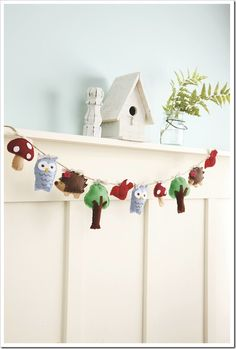 This is for inspiration... I'm sure I can make something very similar... :) Woodland garland - Patterns in From Felt to Fabulous { EverythingEtsy.com}