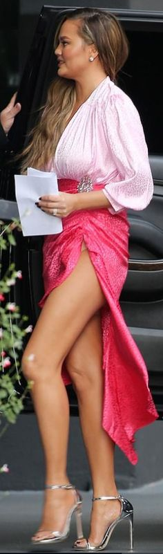 cee65265d61 Who made Chrissy Teigen's silver ankle strap sandals, pink ruched skirt,  and long sleeve