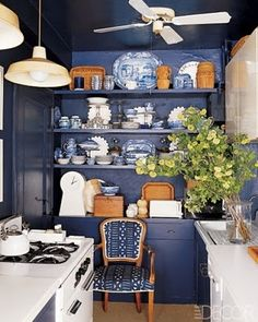 T. Keller Donovan's kitchen from Elle Decor. Navy with natural accents.