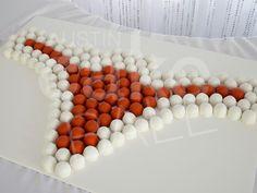 A University of Texas Longhorn groom's cake ball cake.