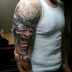 Chronic Ink Tattoo - Toronto Tattoo - Samurai helmet tattoo in progress by Master Ma. Cover up of a tribal tattoo.